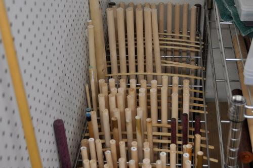 Here is a rack of shaft wood in various stages of cutting and seasoning