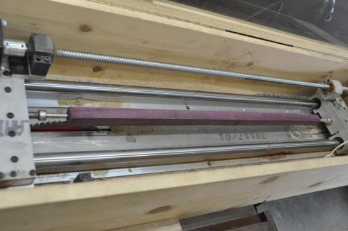 A purpleheart square set to turn round on the CNC saw machine