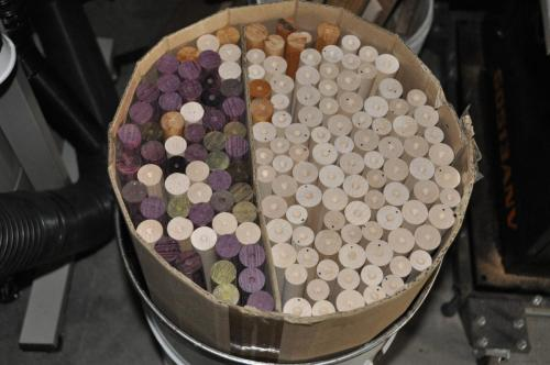 A barrel of first cut shafts and cores.  Maple, Purpleheart, Lignum Vitae and Goncolo Alves